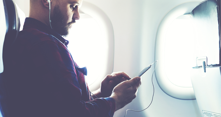 Blog Thumbnail - 5 Podcasts to Download Before Your Next Flight