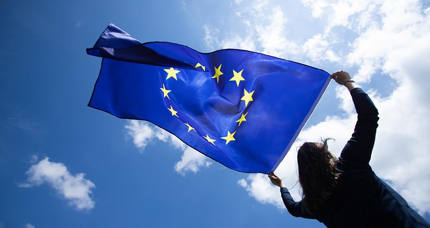 Blog Thumbnail - Reopening European Countries Woman holding a EU flag