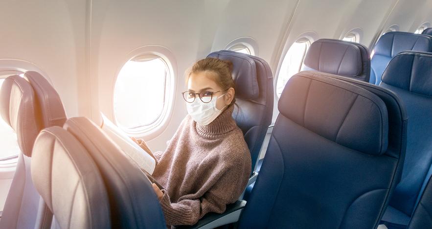female passenger wearing mask on plane